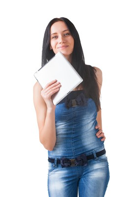Young girl posing in studio with tablet pc