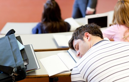 Asleep male student during an university lesson